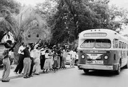Protestors waving bus by